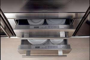"Two Wolf 30"" Warming Drawers stacked and holding dishes"