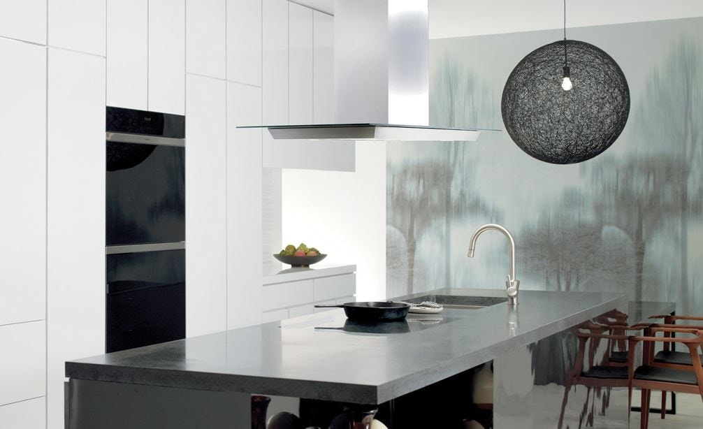 "Wolf 30"" Contemporary Induction Cooktop (CI304C/B) featured in large open kitchen with sleek smooth eat in granite island"