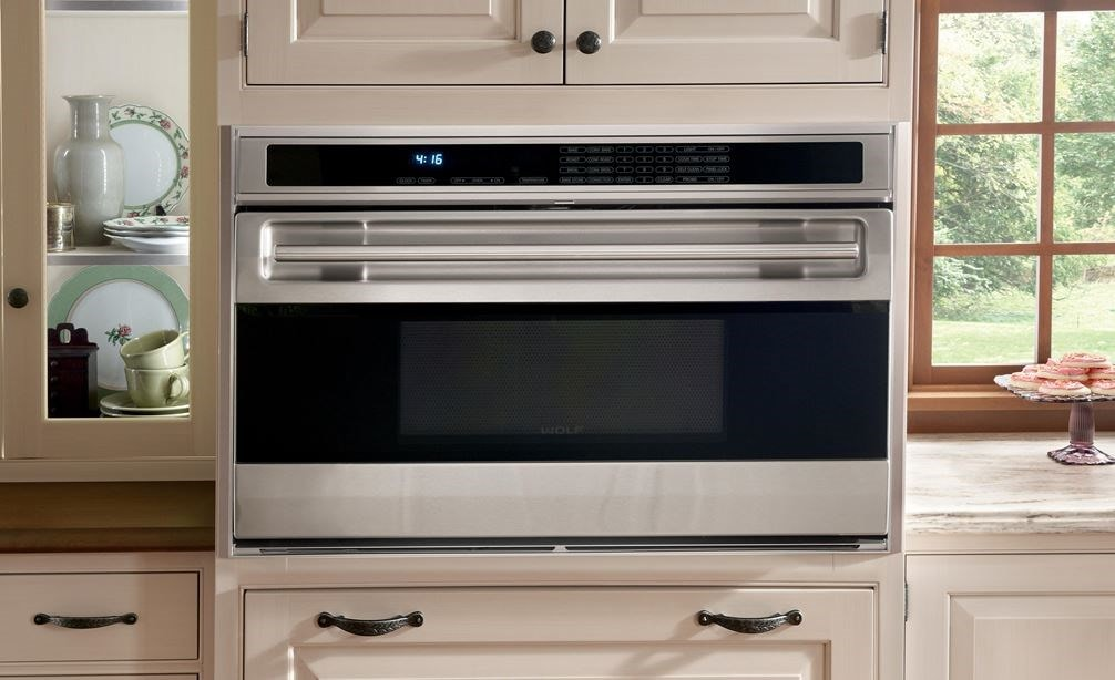 "The Wolf 36"" L Series Oven (SO36U/S) shown integrated into a clean classic vintage kitchen design adding edible and visual gourmet results."