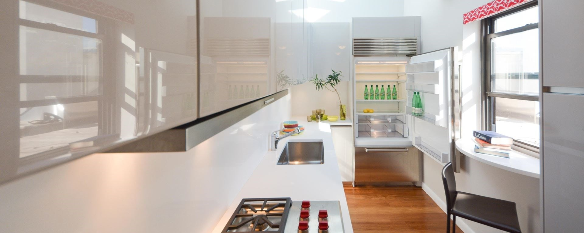 "Clean and crisp kitchen design featuring the Sub-Zero 36"" Classic Over and Under Refrigerator Freezer in a galley style white kitchen"
