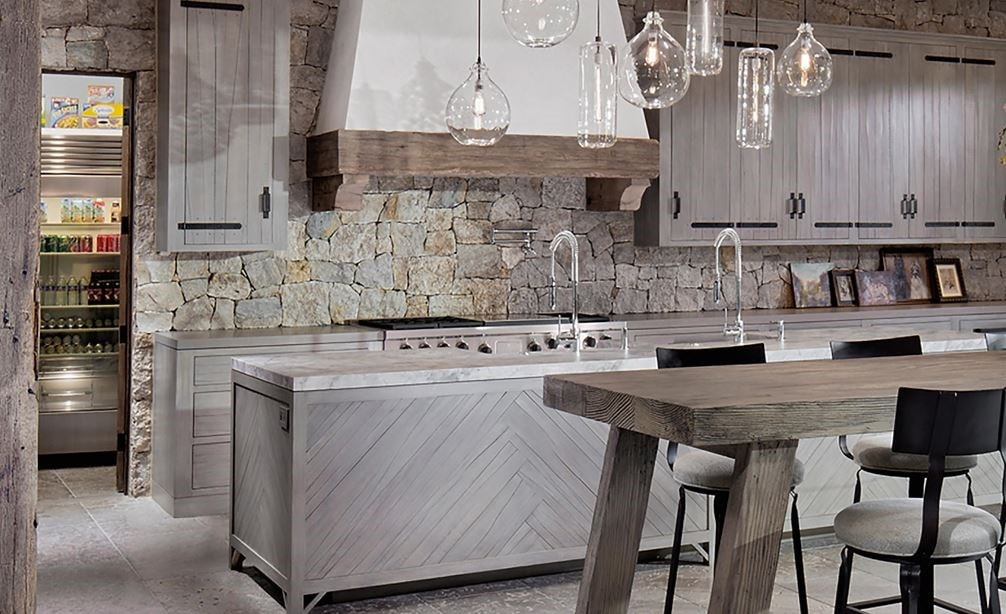 "Wolf 58"" Pro Hood Liner - 22"" Depth (PL582212) shown in custom range hood in large open kitchen blending modern and rustic design elements"