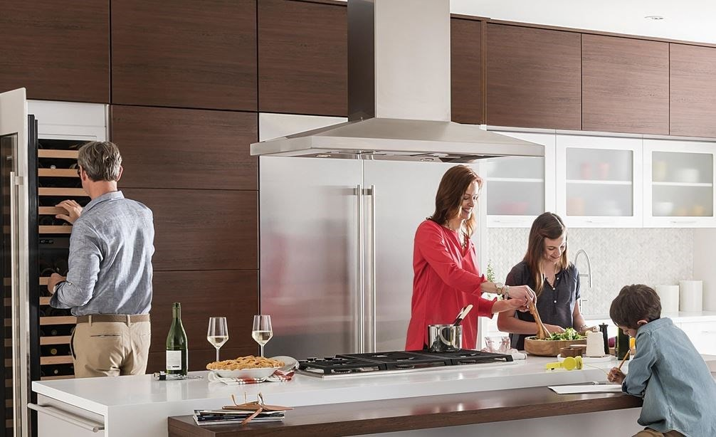 "Wolf 42"" Cooktop Island Hood Stainless (VI42S) shown in large open kitchen space providing beautiful, powerful and safe kitchen ventilation"