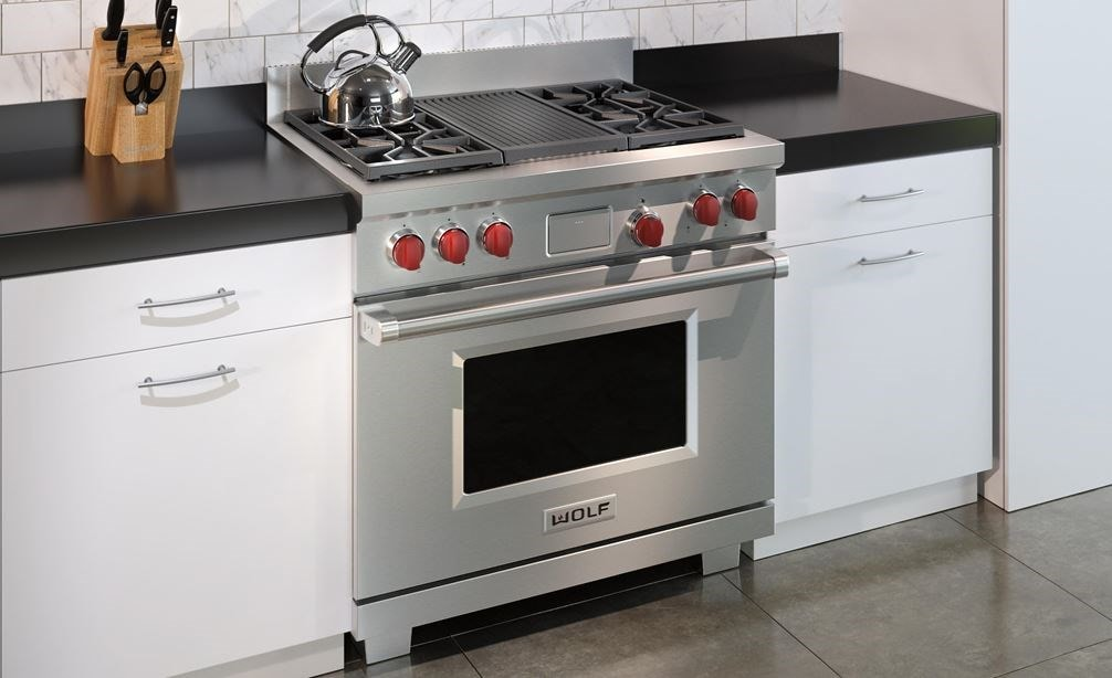 "The Wolf 36"" Dual Fuel Range 4 Burner Infrared Charbroiler (DF364C) shown in a clean contemporary kitchen design."