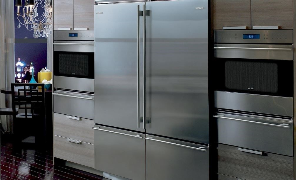 "Pair of Wolf 30"" E Series Transitional Classic Single Ovens (SO30TE/S/TH) on each side of Sub-Zero 30"" Classic Over Under Refrigerator (BI-30U/S)"