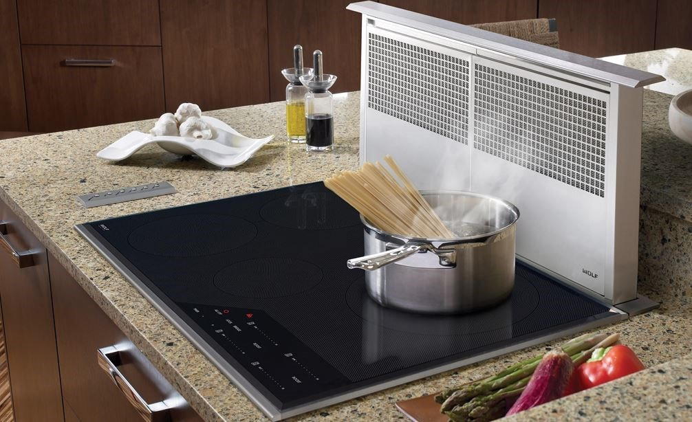 "Wolf 30"" Transitional Induction Cooktop (CI304T/S) paired with 30"" Downdraft Ventilation (DD30) in rich granite countertops"
