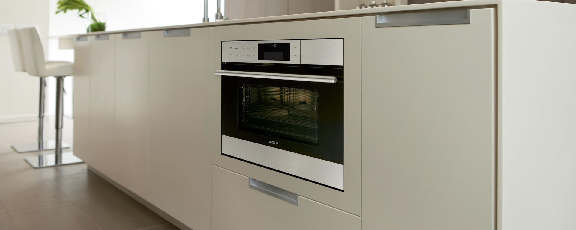 Wolf convection steam oven built-in next to Sub-Zero undercounter refrigeration