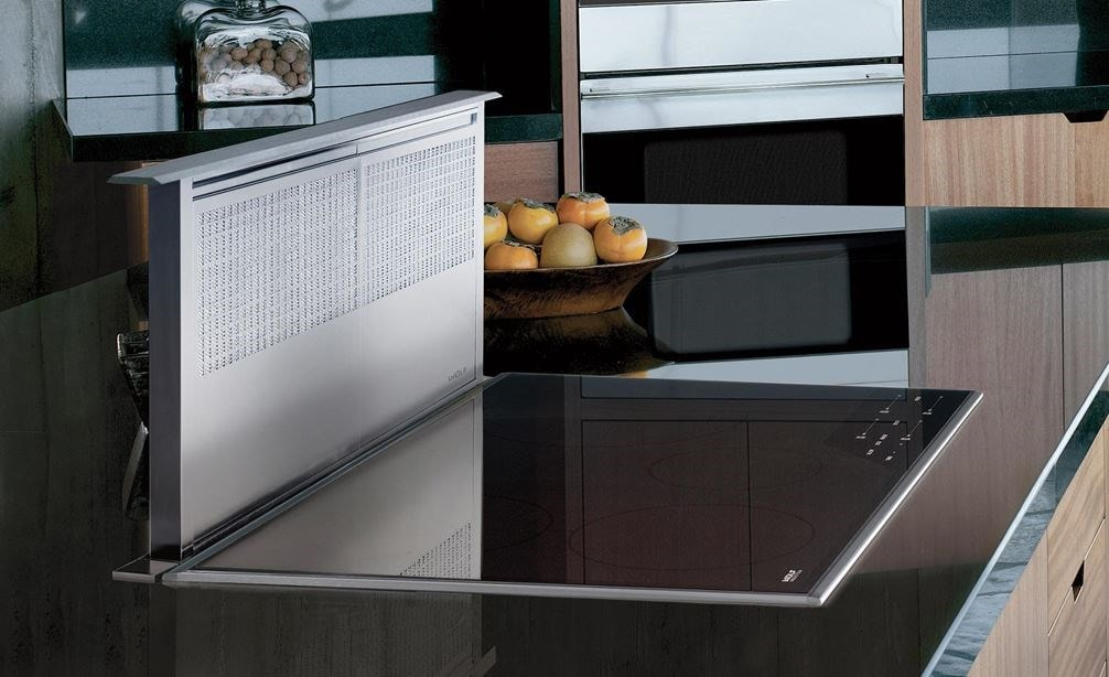 "The Wolf 36"" Transitional Induction Cooktop (CI365T/S) shown with 36"" Downdraft Ventilation (DD36) in large smooth granite countertop"