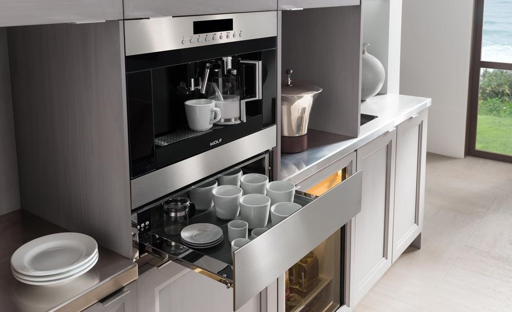 "The Wolf 24"" Cup Warming Drawer Stainless Steel (CW24/S) shown paired with the Wolf 24"" Coffee System Stainless Steel (EC24/S)"