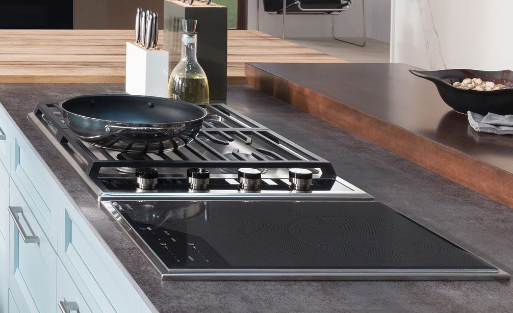 "The Wolf 15"" Transitional Induction Cooktop (CI152TF/S) shown with Wolf 45"" Cooktop Island Hood - Glass (VI45G) in large open kitchen"