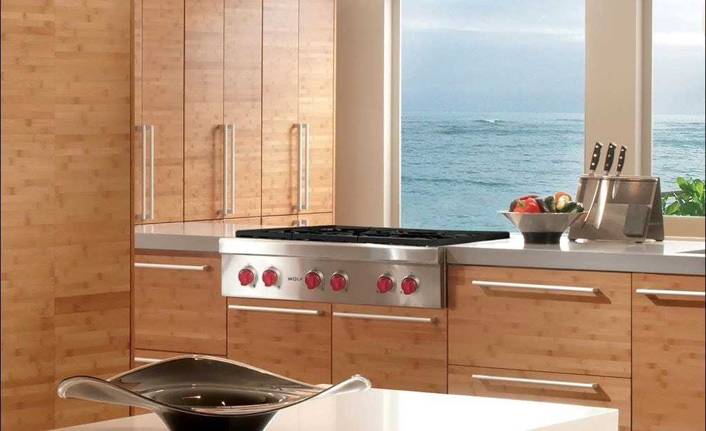 "The Wolf 36"" Sealed 4 Burner Rangetop and Infrared Griddle (SRT364G) featured in a large modern eat-in kitchen."