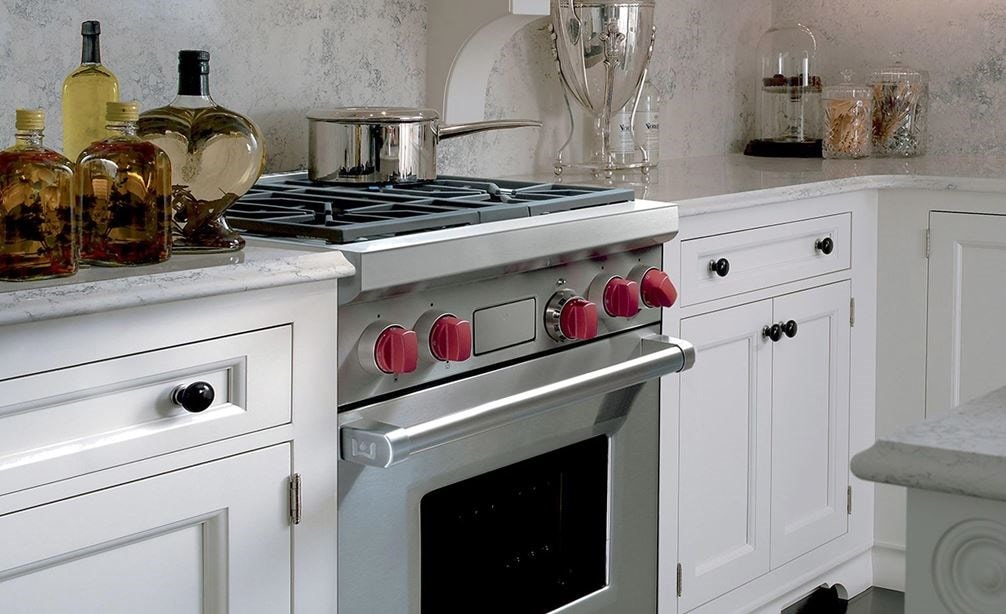 "The Wolf 30"" Dual Fuel Range 4 Burner (DF304) Cooktop shown beautifully integrated into a classic kitchen design."