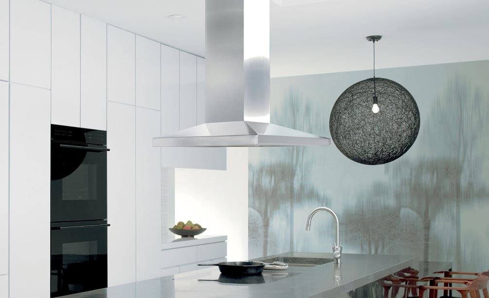 "Wolf 42"" Cooktop Island Hood Stainless (VI42S) shown adding a polished touch as the centerpiece in this sleek black and white design"