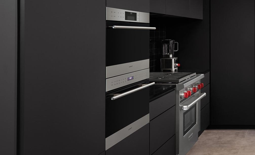 "Wolf 24"" E Series Transitional Convection Steam Oven (CSO24TE/S/TH) shines in contemporary deep-toned seamless kitchen cabinets."