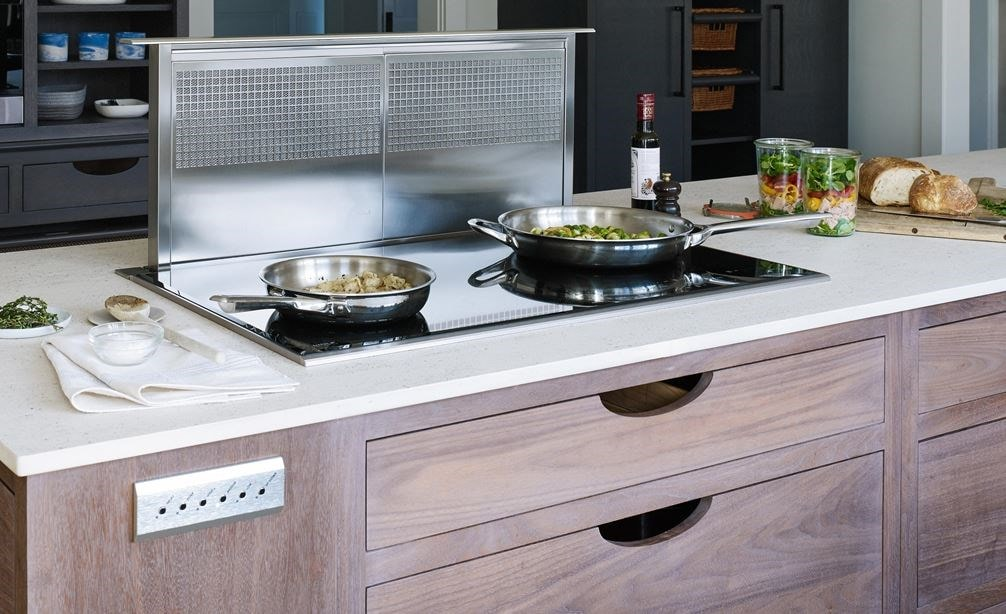 "Wolf 36"" Downdraft Ventilation (DD36) shown with Wolf 36"" Transitional Induction Cooktop (CI365T/S) in natural wood finish kitchen island"