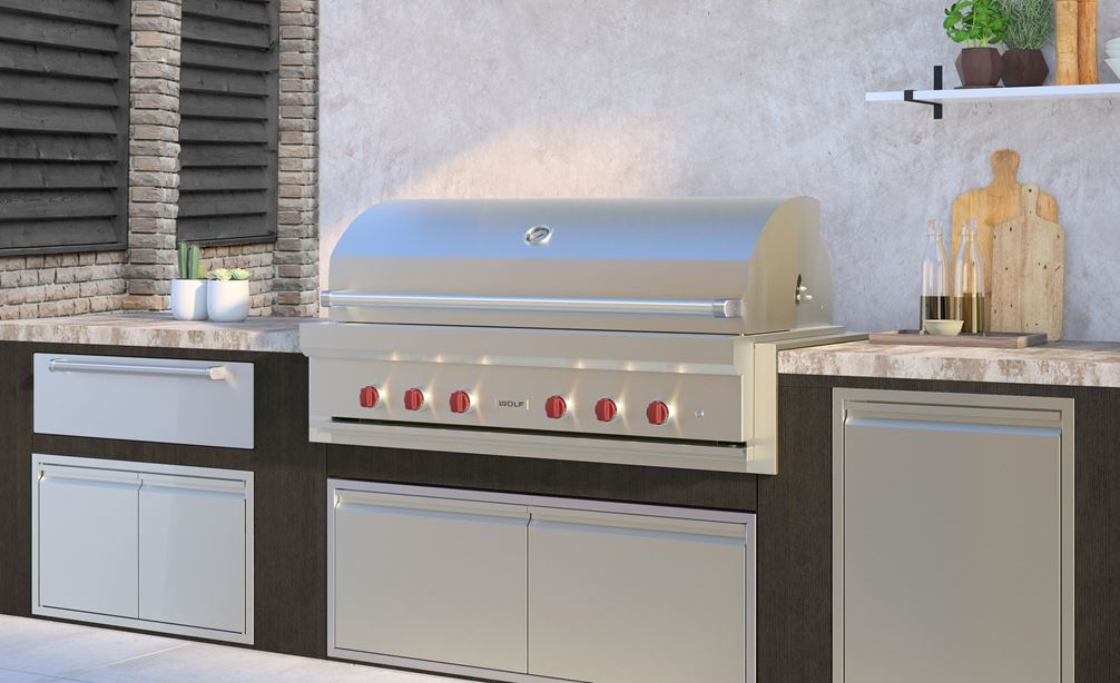 "The Wolf 54"" Outdoor Gas Grill (OG54) shown in a luxury outdoor kitchen featuring professional grade Wolf Outdoor Kitchen appliances."