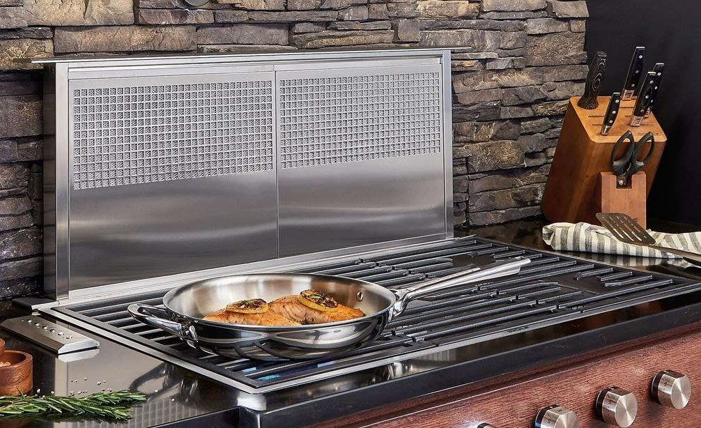 "Wolf 36"" Downdraft Ventilation (DD36) shown with 36"" Contemporary Gas Cooktop 5 Burner (CG365C/S) in a kitchen design of rich textures"