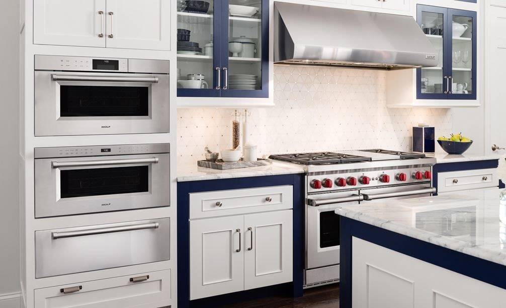 "The Wolf 30"" M Series Professional Convection Steam Oven (CSO30PM/S/PH) shown with Wolf 30"" Warming Drawer (WWD30)"