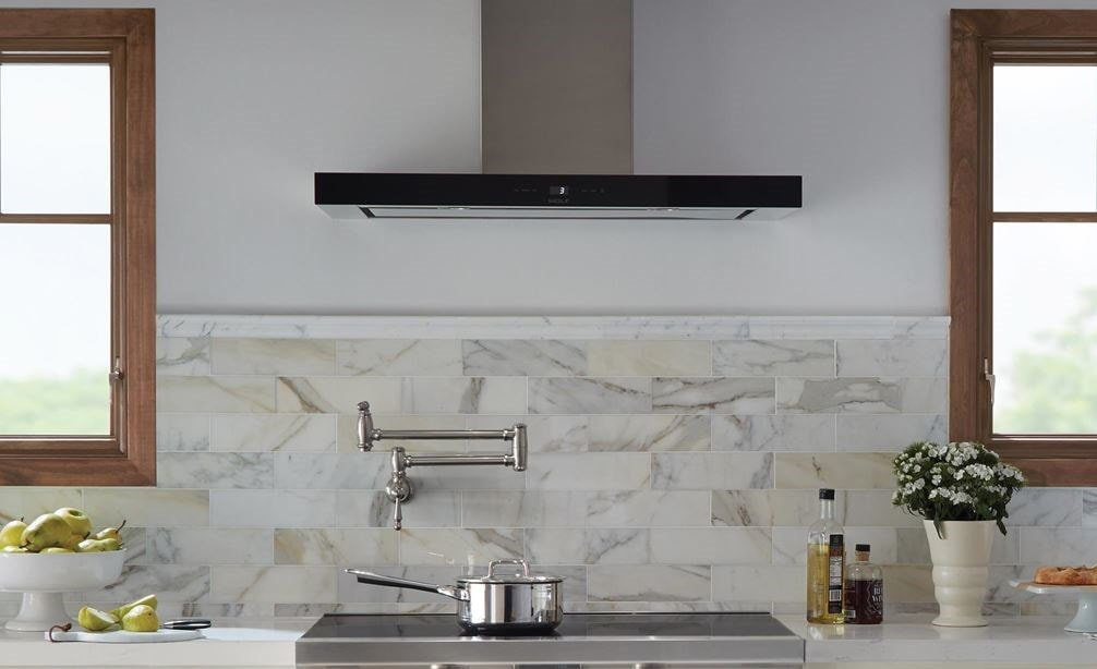 "Wolf 36"" Cooktop Wall Hood - Black (VW36B) shown in a bright, open and clean design featuring classic country cabinetry and tile floors"