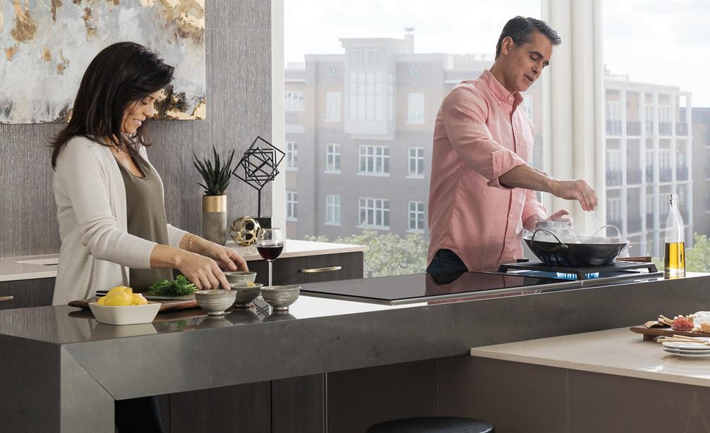 "The Wolf 30"" Transitional Induction Cooktop (CI304T/S) set in large modern and modular countertop in open kitchen"
