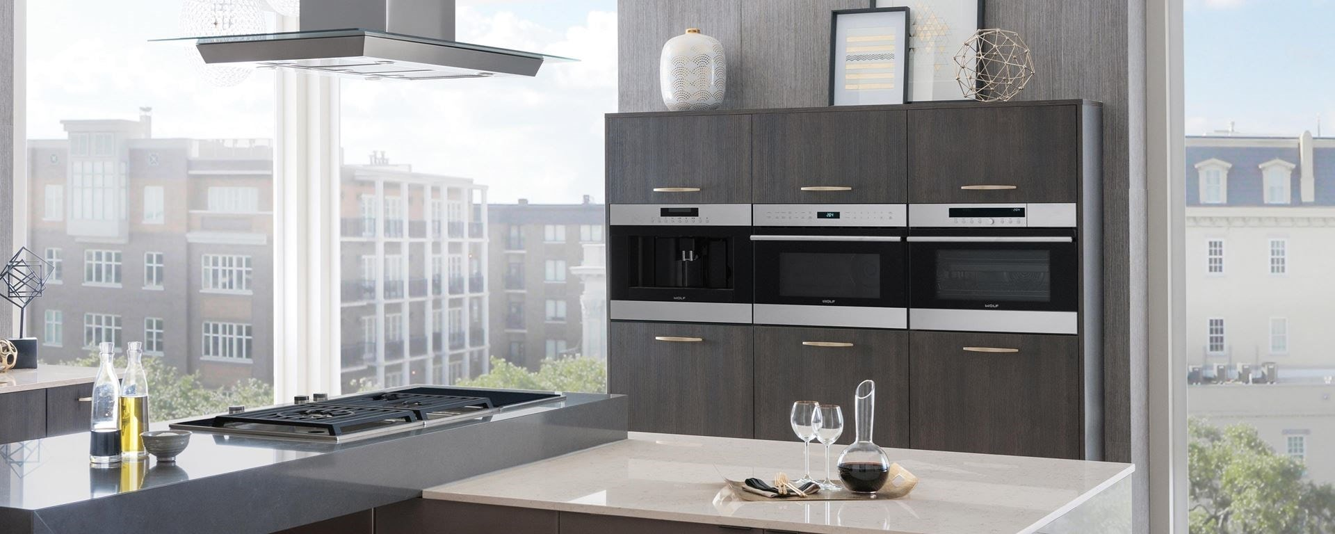 Wolf kitchen featuring a Wolf coffee system, electric cooktop, convection steam oven, microwave, specialty modules and ventilation