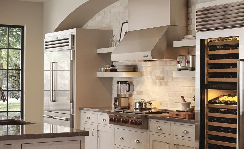 "Wolf 42"" Pro Wall Hood 24"" Depth (PW422418) shown with 30"" M Series Professional Single Oven (SO30PM/S/PH) in rustic country kitchen"