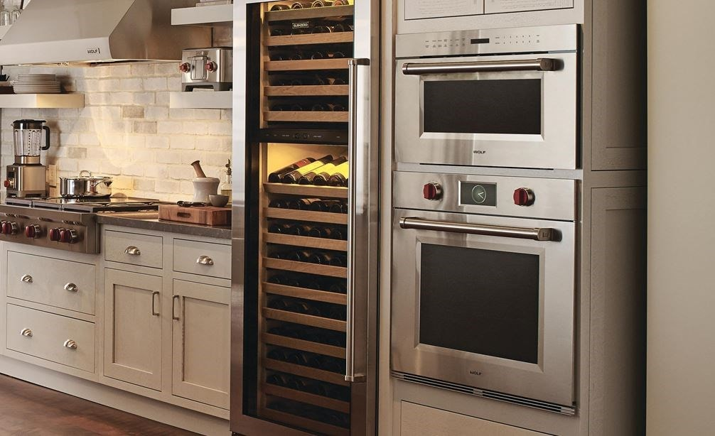 "Wolf 30"" M Series Professional Single Oven (SO30PM/S/PH) with Wolf 42"" Pro Wall Hood 24"" Depth (PW422418) shown in rustic country kitchen"