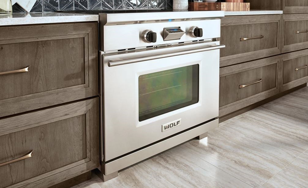 "The Wolf 36"" Transitional Induction Range (IR365TE/S/TH) featured with Wolf Gourmet Cutlery (WGCU100S)"