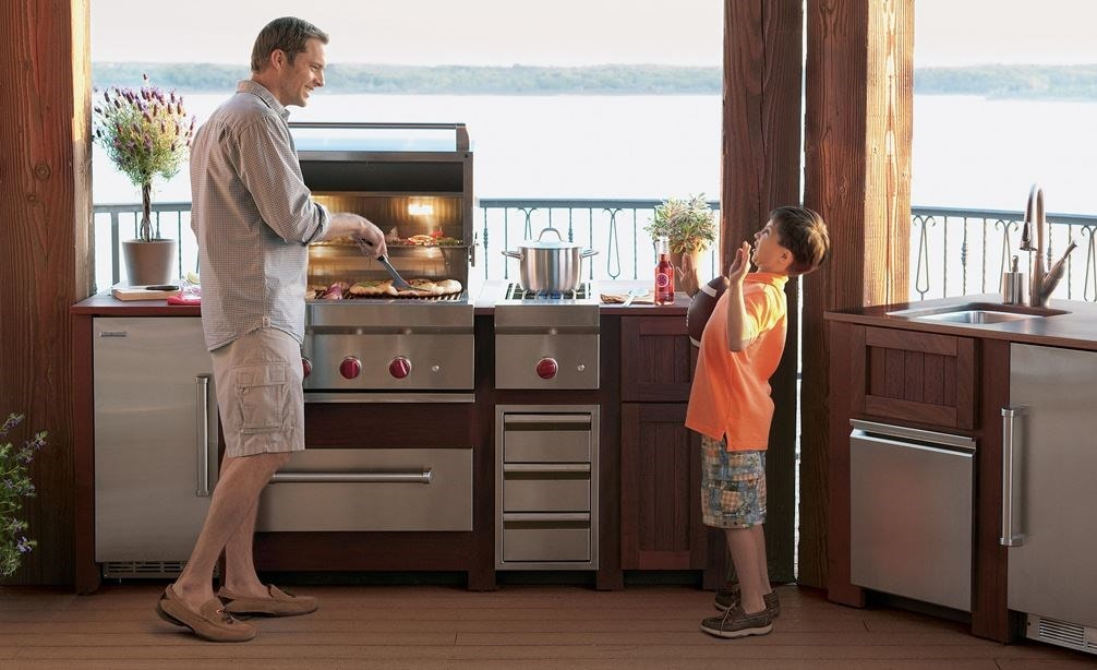 "The Wolf 30"" Outdoor Warming Drawer (WWD30O) shown in a gourmet outdoor cooking area featuring best-in-class Wolf cooking appliances"