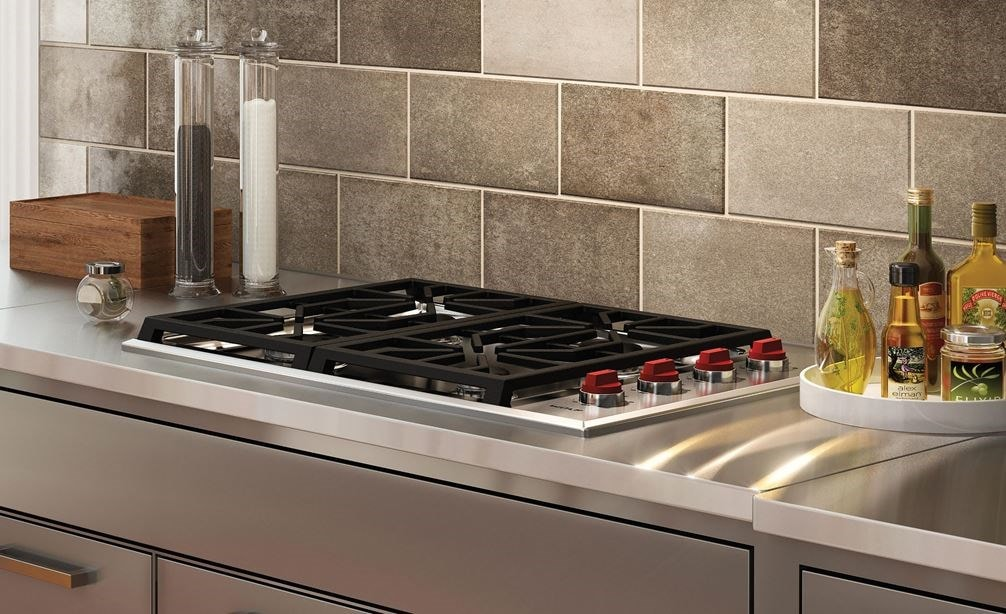 "The Wolf 30"" Professional Gas Cooktop 4 Burner (CG304P/S) shown paired with Wolf 30"" Cooktop Wall Hood - Stainless (VW30S)"