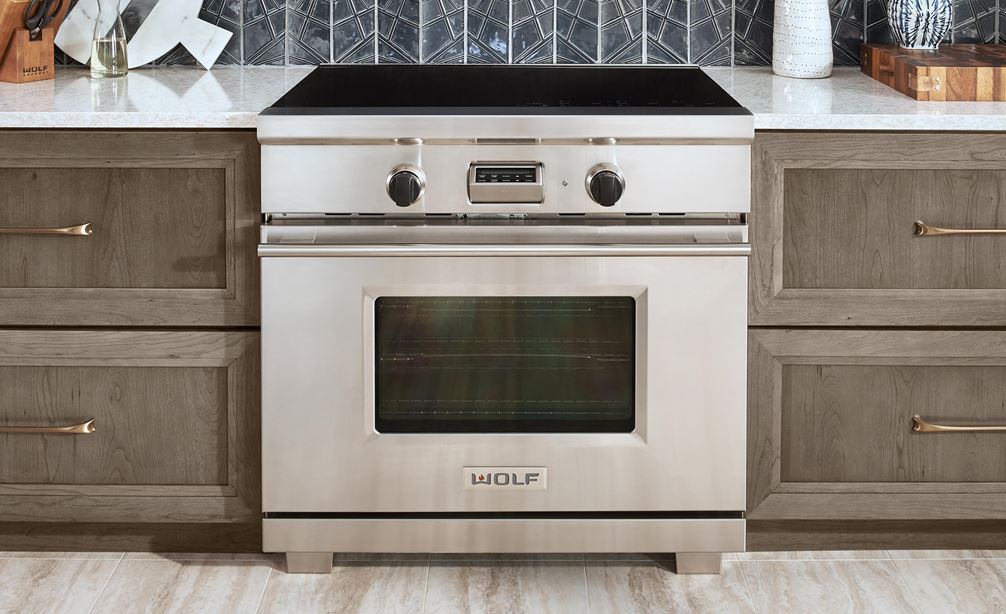 "The Wolf 36"" Transitional Induction Range (IR365TE/S/TH) featured with Wolf 36"" Cooktop Wall Hood - Glass (VW36G)"