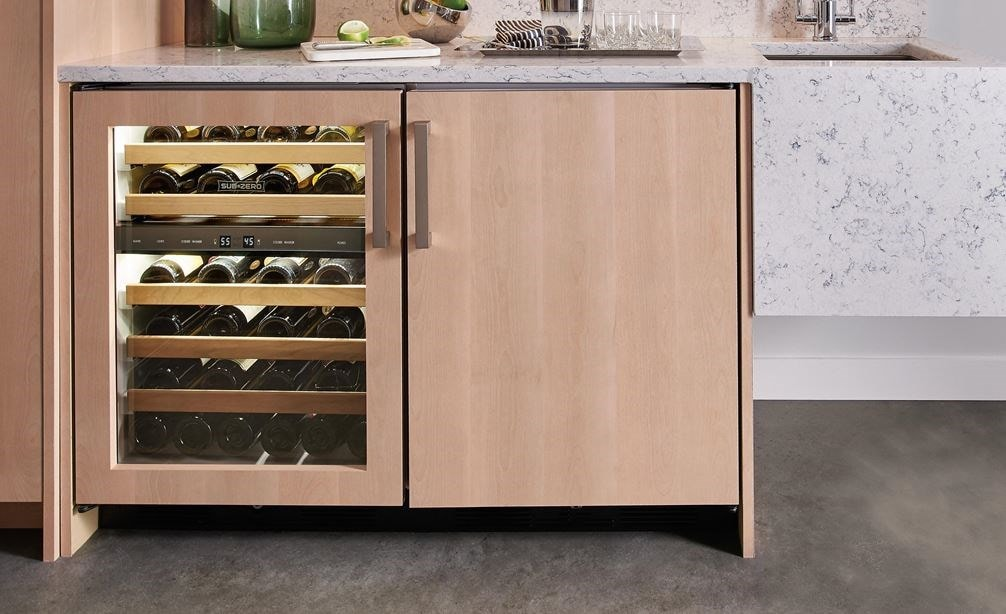 "Sub-Zero 24"" Undercounter Wine - Panel Ready (UW-24/O) shown in clean modern space."