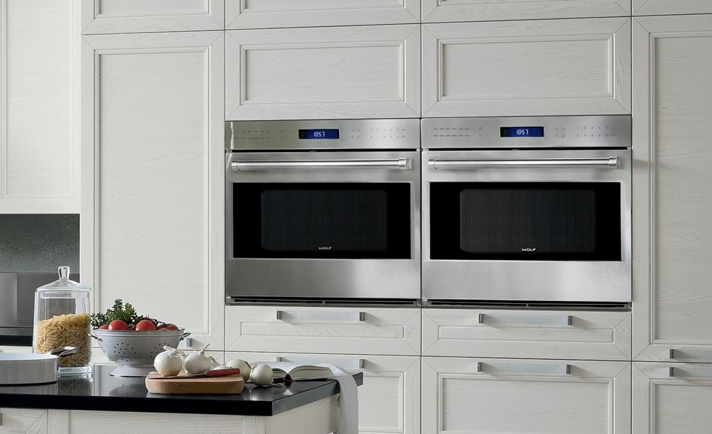 "A Pair of Wolf 30"" E Series Professional Classic Single Ovens (SO30PE/S/PH) displayed expertly within clean kitchen cabinetry."