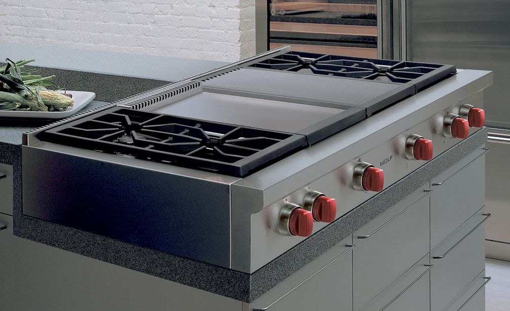 "The Wolf 48"" Sealed 4 Burner Rangetop Infrared Charbroiler and Griddle (SRT484CG) fits superbly into custom granite countertops."