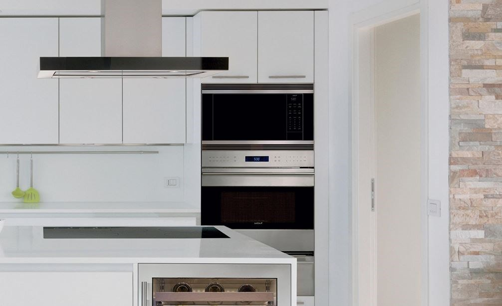 "Wolf 24"" Standard Microwave Oven (MS24) displayed in large open classic white kitchen design featuring smooth cabinets and countertops"