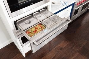"Wolf 30"" Warming Drawer (WWD30) open holding an entrée and several sides containers"