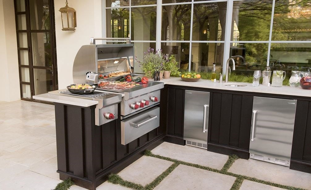 "The Wolf 30"" Outdoor Gas Grill (OG30) showing it's ability to provide gourmet chef-style cooking in any luxury outdoor dining space."