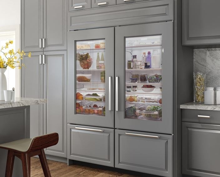 "Sub-Zero Classic full size 30"" french door fridge with glass doors and custom panel overlay"