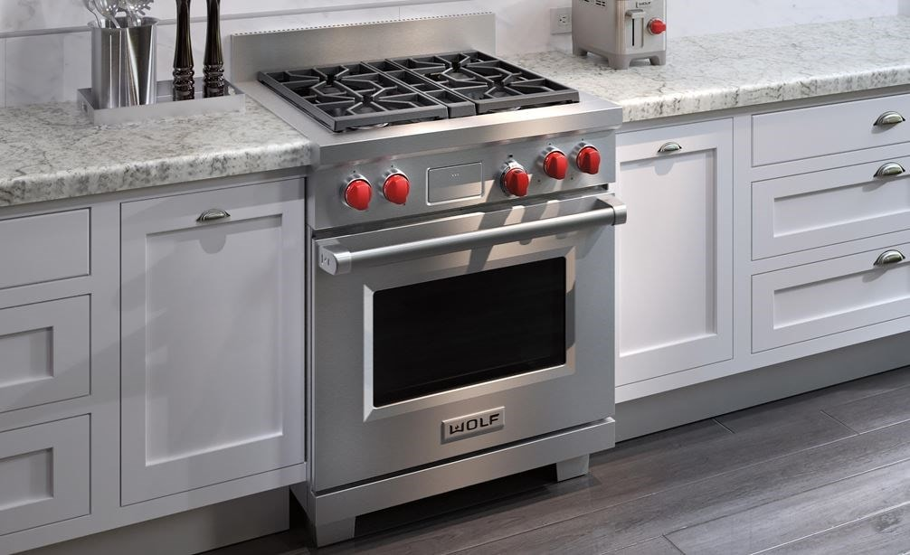 "The Wolf 30"" Dual Fuel Range 4 Burner (DF304) Cooktop displayed in a clean modern contemporary kitchen design."
