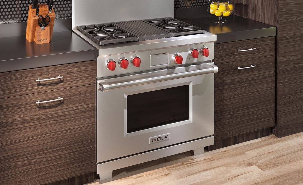 "The Wolf 36"" Dual Fuel Range 4 Burner Infrared Charbroiler (DF364C) shown delivering state of the art cooking technology in a natural kitchen design."