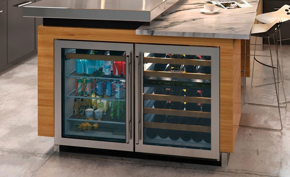 "Sub-Zero 24"" Undercounter Beverage Center (UC-24BG/S) paired with Sub-Zero 24"" Undercounter Wine (UW-24/S) in a modern kitchen design."