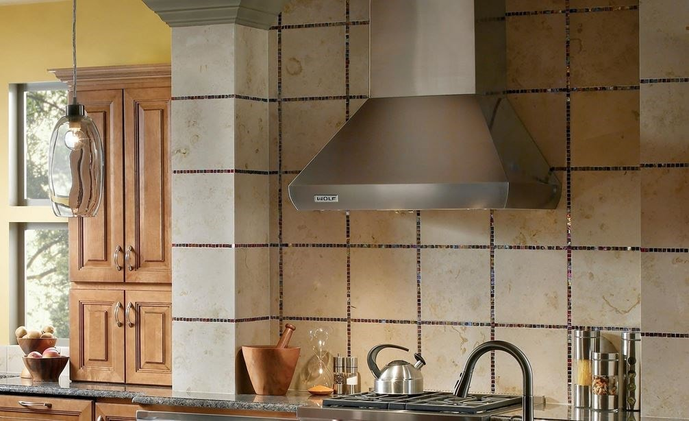 "Wolf 36"" Pro Wall Chimney Hood (PWC362418) is a centerpiece in any traditional kitchen design adding strong presence and ventilating power"