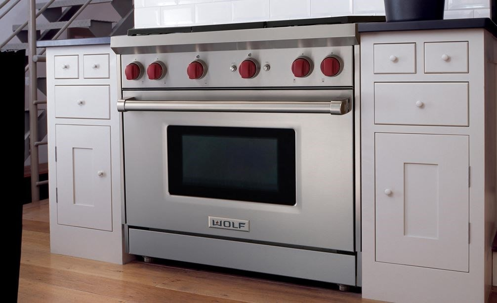 "The Wolf 36"" Gas Range 6 Burner (GR366) Rangetop shown blending seamlessly into a simple and elegant kitchen design."