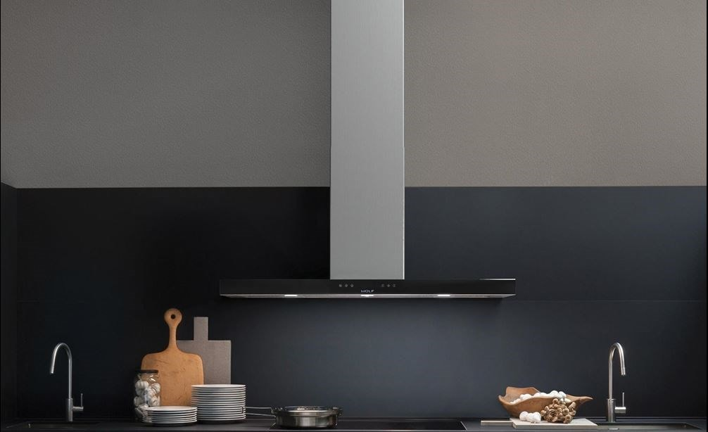 "The Wolf 45"" Cooktop Wall Hood - Black (VW45B) shown blending seamlessly into a sleek dark tone contemporary room design."