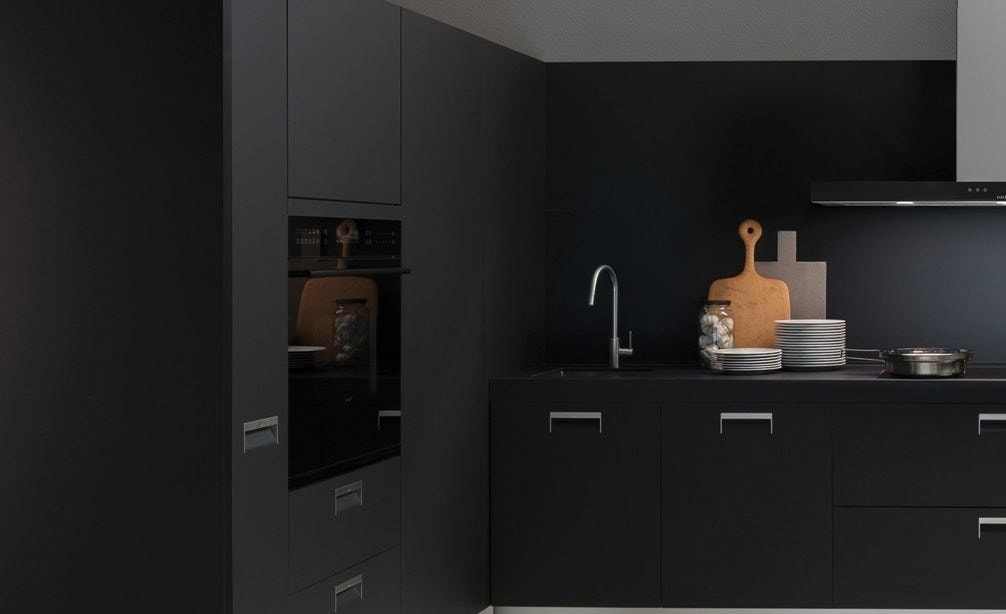 "The Wolf 30"" E Series Contemporary Single Oven (SO30CE/B/TH) shown blending seamlessly into a sleek dark tone contemporary room design."