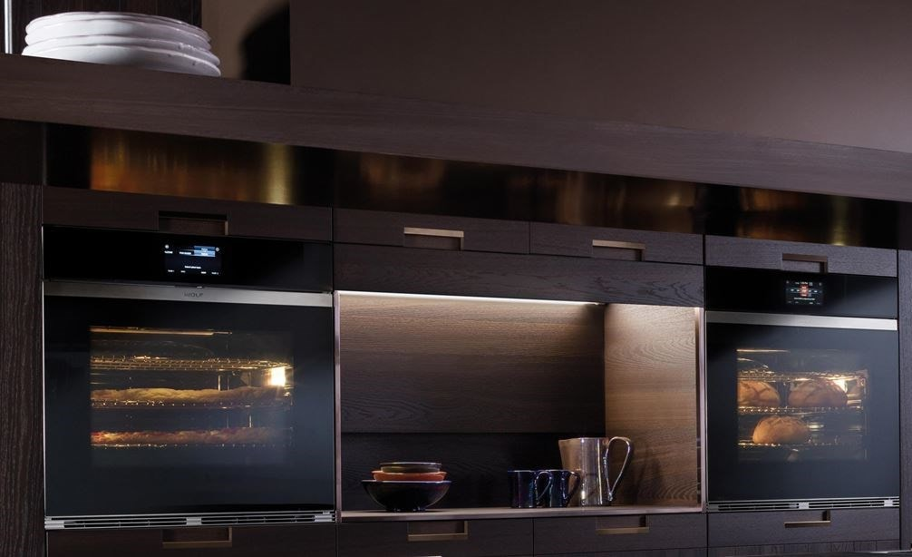 "Wolf 30"" M Series Contemporary Black Glass Single Oven (SO30CM/B) shown with bright halogen lights offering a clear view of your dish"