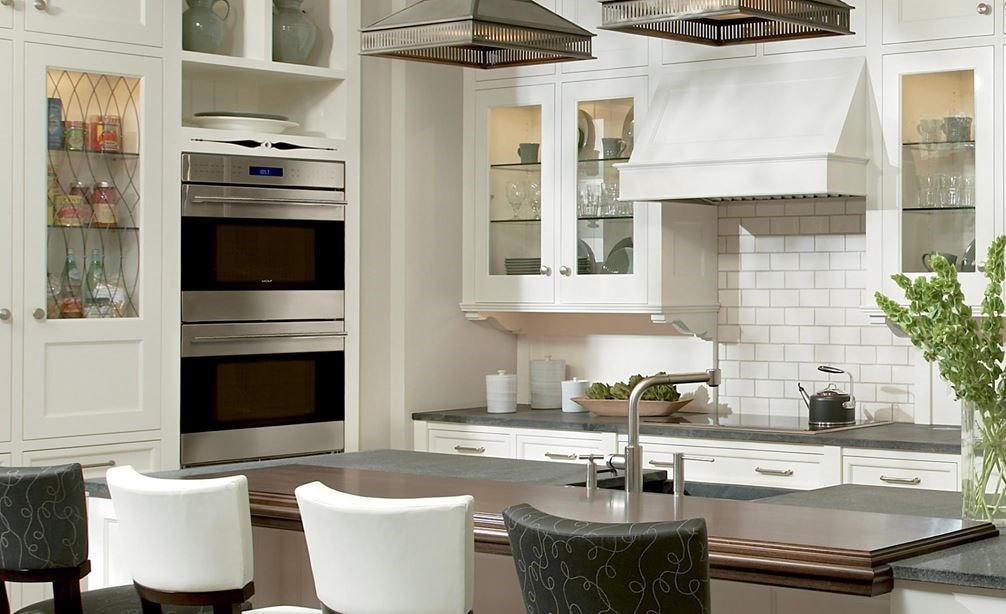 "The Wolf 30"" E Series Transitional Built-In Double Oven (DO30TE/S/TH) shown complementing a crisp integrated classic kitchen design."