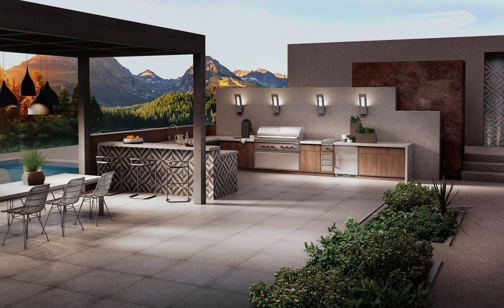 "The Wolf 54"" Outdoor Gas Grill (OG54) shown blending seamlessly into a rich modern outdoor kitchen design offering pro quality amenities."