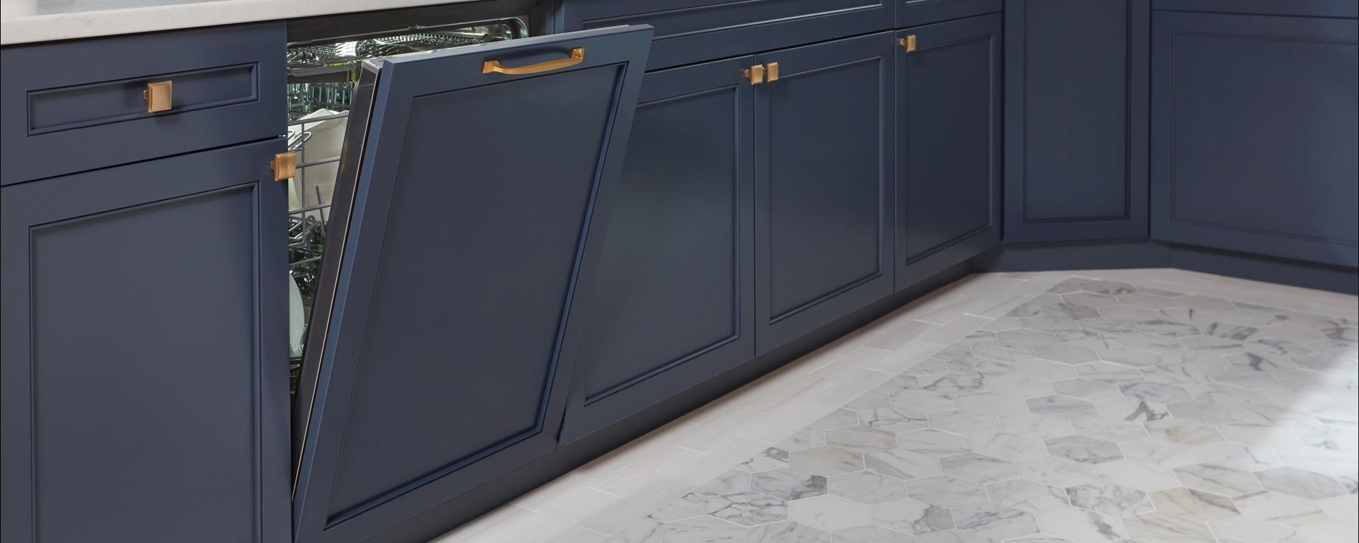 "Cove 24"" built-in dishwasher (DW2450WS) with custom panel to match kitchen cabinetry"