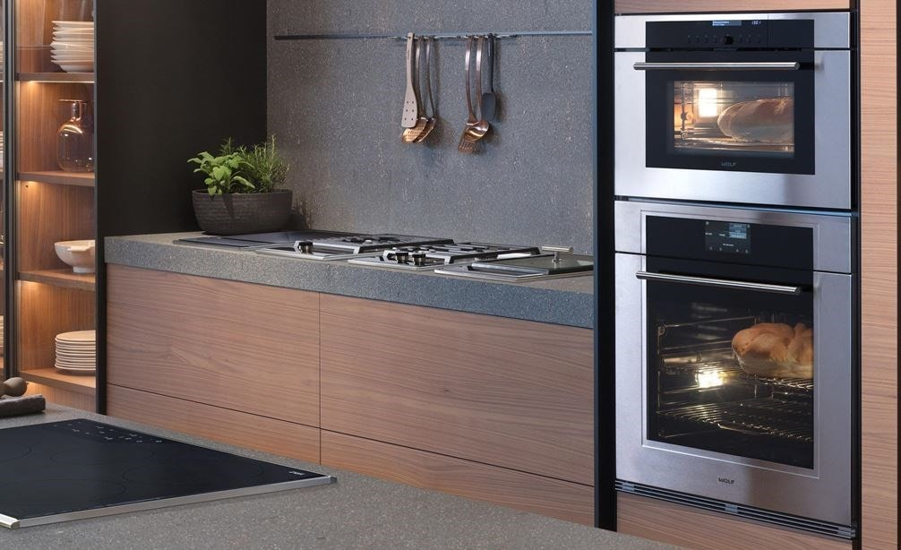 "Wolf 30"" M Series Transitional Convection Steam Oven (CSO30TM/S/TH) displayed in an elegant arrangement of warm smooth kitchen cabinets"