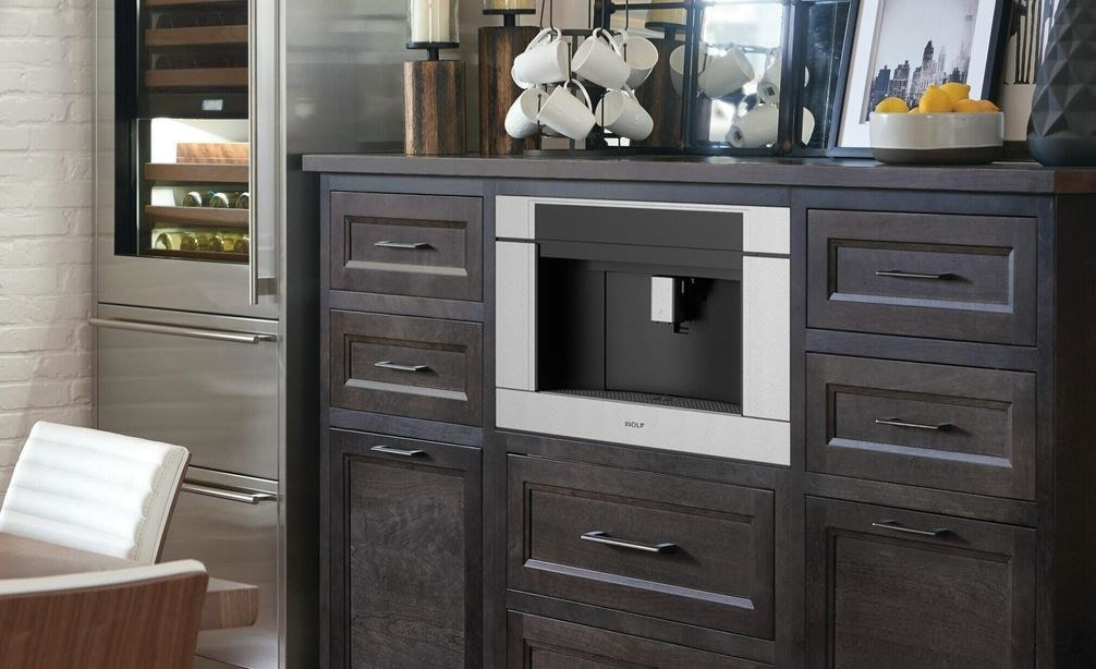 "The Wolf 24"" Coffee System Black Glass (EC24/B) shown set in a rustic pantry-style coffee station conveniently located in dining room"